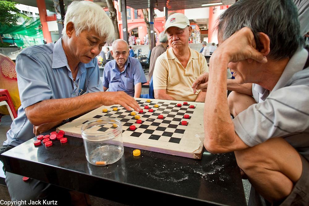 Apr. 28 -- SINGAPORE:  Men play checkers in the Chinatown neighborhood of Singapore.    PHOTO BY JACK KURTZ
