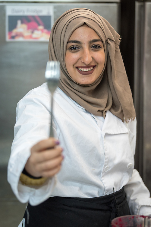 25 February 2020, Jerusalem: Sana'a Siam, from the Old City in Jerusalem, holds up a fork during catering class at the vocational training centre in Beit Hanina. The Lutheran World Federation's vocational training centre in Beit Hanina offers vocational training for Palestinian youth across a range of different professions, providing them with the tools needed to improve their chances of finding work.
