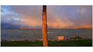 An orange sky over Traverse Bay on a beautiful stormy morning at Elk Rapids, Michigan, USA