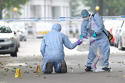 © Licensed to London News Pictures. 31/05/2018. London, UK. Forensics officers on Finborough Road near Cathcart Road, Kensington, where a man believed to be in his 40s was found with multiple stab wounds. The man died at the scene and a murder investigation has been launched. Photo credit: Rob Pinney/LNP