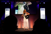 Kristen Franke displays a black leather concealed carry purse during the National Rifle Association (NRA) Carry Guard Expo Fashion Show in Milwaukee, Wisconsin, U.S., August 25, 2017.   REUTERS/Ben Brewer