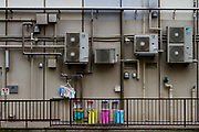 Colourful cleaning loths and towels hanging out to dry at the back of a building in Shibuya, Tokyo, Japan. Tuesday June 23rd 2020