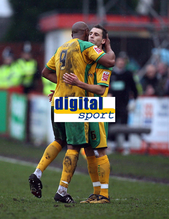Photo: Rich Eaton.<br /> <br /> Tamworth FC v Norwich City. The FA Cup. 06/01/2007. Dion Dublin #9 of Norwich is embraced by fellow goalscorer Darren Hhuckerby shortly before being substituted in the second half