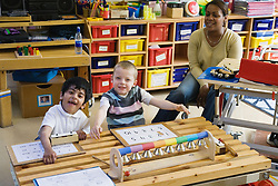 Children with physical and learning disabilities in a music lesson,