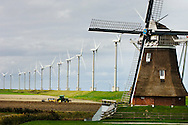 Nederland, Eemshaven,  8 okt  2007.Windpark.Windmolens voor energieopwekking en oude molen.Nieuw en oud. ..Foto (c) Michiel Wijnbergh