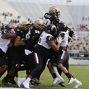 ORLANDO, FL - NOVEMBER 21: Greg McCrae #30 of the Central Florida Knights gets carried into the end zone to score a touchdown at Bounce House-FBC Mortgage Field on November 21, 2020 in Orlando, Florida. (Photo by Alex Menendez/Getty Images) *** Local Caption *** Greg McCrae