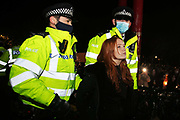 Hundreds of people gathered at a peaceful vigil for Sarah Everard on Clapham Common in South London on the 13th of March 2021, London, United Kingdom. Sarah Everard went missing on 3 March after setting off at 9pm from a friend's house to make her two and a half mile journey home. Police making arrests. The vigil was also a call to end violence against girls and women perpetrated by men. The vigil was not sanctioned by police because of Covid restrictions and the police decided to arrest a number of people in an attempt to end the peaceful and highly emotional vigil. The event took place at the band stand on the common and speeches were held from the stand till police confiscated the sound equipment.