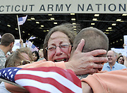 Janet Allegra, of Ellington, hugs her son Spc. John Allegra IV at the Army aviation support facility in Windsor Locks, Conn. About 110 soldiers of the 250th Engineer Co. Connecticut National Guard who were deployed to Iraq last winter have returned home. (AP Photo/Jessica Hill)