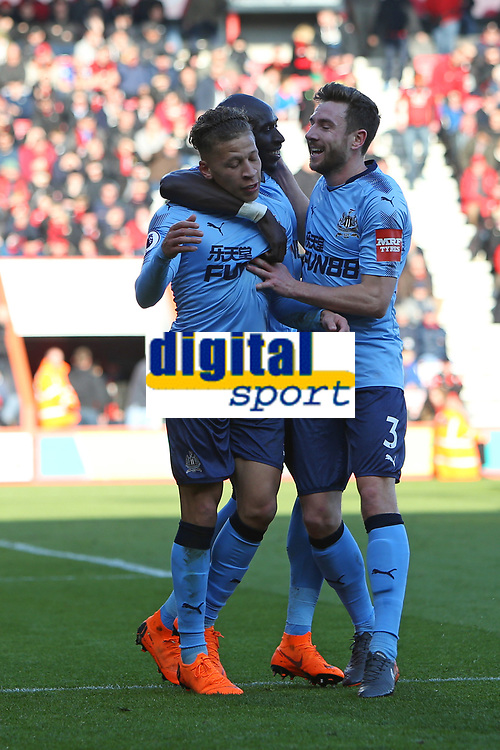 Football - 2017 / 2018 Premier League - AFC Bournemouth vs. Newcastle United<br /> <br /> Paul Dummett and Mohamed Diame  congratulates goalscorer Dwight Gayle of Newcastle United at Dean Court (Vitality Stadium) Bournemouth <br /> <br /> COLORSPORT/SHAUN BOGGUST