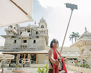 """Selfie stick at the jag Mandir is a palace built on an island in the Lake Pichola. It is also called the """"Lake Garden Palace"""". The palace is located in Udaipur city in the Indian state of Rajasthan. Its construction is credited to three Maharanas of the Sisodia Rajputs of Mewar kingdom."""