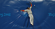 Japanese outfielder unable to make a catch on a fly ball during the 2008 Beijing Olympics baseball competition.