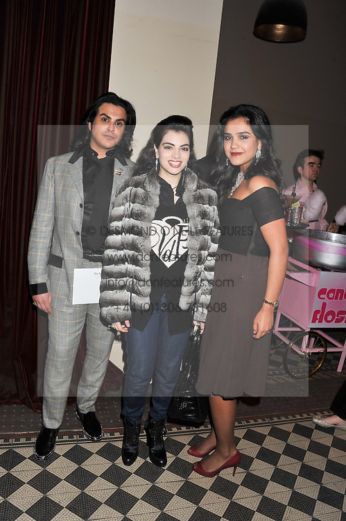 Left to right, PRINCE MUBARAK AL KHALIFA, / and PRINCESS MUNIRA AL KHALIFA at a fashion show featuring designs from Celia Kritharioti Spring/Summer 2012 collection held at One Mayfair, London on 20th March 2012.