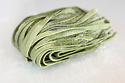 Spinach Linguine pasta on white background