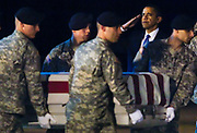 U.S. President Barack Obama participates in the dignified transfer of U.S. Army Sgt. Dale R. Griffin at Dover Air Force Base, Delaware, October 29, 2009. Griffin is one of 18 U.S. personnel who died Monday in Afghanistan and was returned to the U.S. onboard an Air Force C-17 military transport plane.   REUTERS/Jim Young