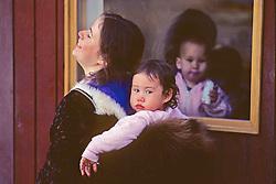 Woman & Child In Window