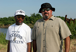 01 June 2010. Breton Sound Marina, Hopedale, Louisiana, USA.  <br /> Spike Lee and bodyguard Marco Umana at the Breton Sound Marina in Hopedale for his latest movie,  'If God is Willing and da Creek Don't Rise.'<br /> Photo; Charlie Varley.
