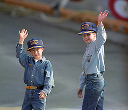 File photo dated 23/10/1991 of Prince William, 9, and his younger brother, Prince Harry, 7, wear baseball-style caps given to them by the crew of the Canadian frigate HMCS Ottowa after they toured the ship which was moored alongside the Royal Yacht Britannia on the Toronto waterfront.