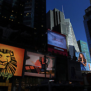 """Times Square, the major commercial intersection in Midtown Manhattan, New York City, at the junction of Broadway and Seventh Avenue and stretching from West 42nd to West 47th Streets. Times Square, iconified as """"The Crossroads of the World"""" is the brightly illuminated hub of the Broadway theater district and one of the world's busiest pedestrian intersections. Time Square, New York, USA. 27th April 2012. Photo Tim Clayton"""