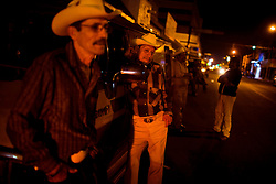 """Musicians that sing """"corridos"""", or ballads, wait for customers to hire them on a street in downtown Culiacan.  These musicians are famous for writing narco-ballads, detailing the lives of drug dealers.  The narcos hire the musicians, paying as much as $1000 to write and record a ballad about their lives.  In recent years, scores of the musicians have been killed in what is believed to be drug related murders."""