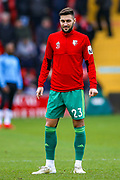 Watford defender Marc Navarro (23) warms up before during the The FA Cup 3rd round match between Woking and Watford at the Kingfield Stadium, Woking, United Kingdom on 6 January 2019.