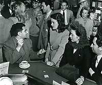 1945 Sidney Skolsky chats with movie fans at Schwab's Drugstore