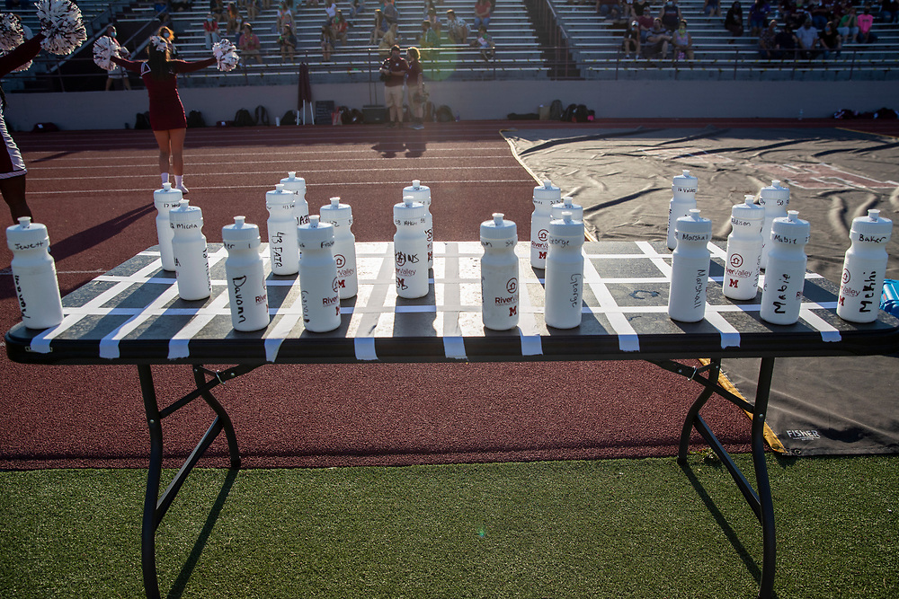 Mishawaka player water bottles on table separated by tape during the Marian-Mishawaka high school football game on Friday, August 21, 2020, at Steele Stadium in Mishawaka, Indiana.