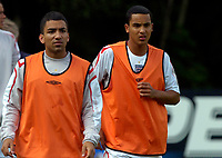 Photo: Richard Lane.<br />England Training Session. 22/05/2006.<br />Aaron Lennon (L) and Theo Walcott warm up during training.