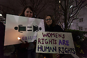 Women hold signs calling for the respect of reproductive rights protest march by members of the Democratic Party Abroad organisation to mark the inauguration of President Donald Trump, Tokyo, Japan. Friday January 20th 2017 Around 400 people took apart in the march, which started in Hibiya Park at 6:30pm and finished in Roppongi just before 8pm, to honour the service given by President Obama and to protest against the illiberal policies expected of the new administration of President  Trump.