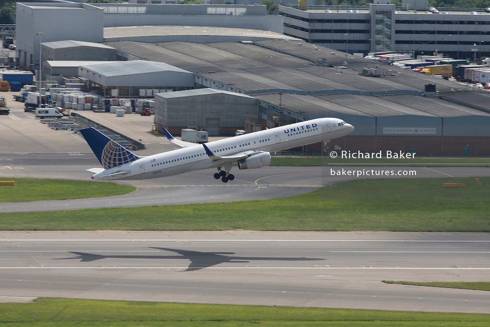 United Airlines Boeing airliner takes-off from southern runway at London Heathrow Airport.