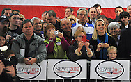 February 17, 2012 PEACHTREE CITY: Supporters watch and take photos as   Newt Gingrich speaks during his rally at Peachtree City-Falcon Field in Peachtree City on  Friday, February 17, 2012.  Newt is running for president of the United States.   ©2012 Johnny Crawford