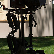 Silhouette of a movie camera on set.