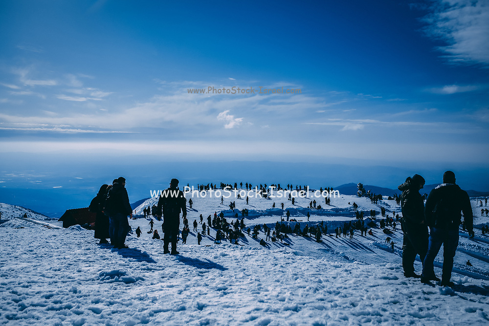 many Holidaymakers on a snow covered mountain peak