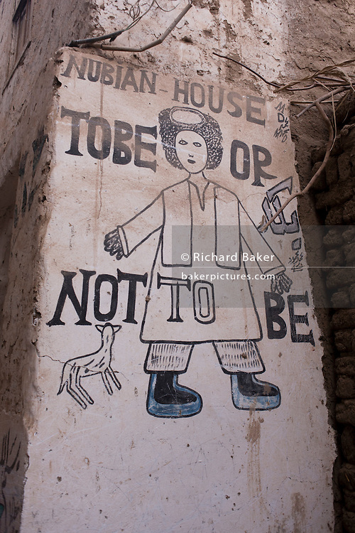 A Shakepearean quote written on the wall of a house in the village of Bairat on the West Bank of Luxor, Nile Valley, Egypt.
