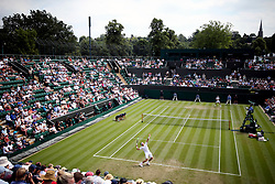 Milos Raonic in action against John Millman on day three of the Wimbledon Championships at the All England Lawn Tennis and Croquet Club, Wimbledon.