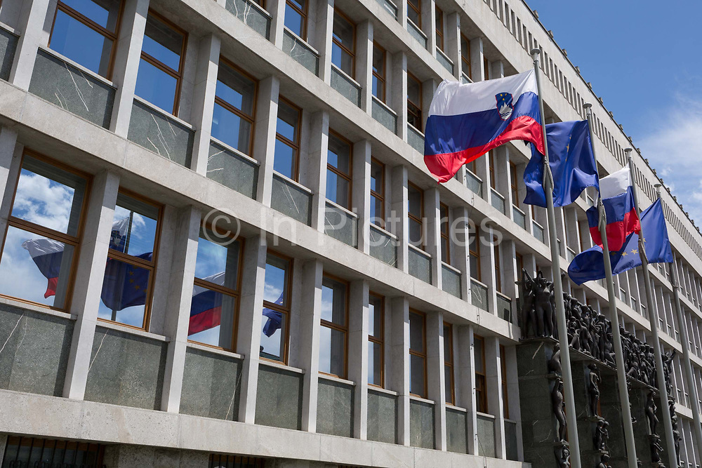 The exterior of the Slovenian Peoples And National Assembly Parliament building, by Vinko Glanz 1960 in the Slovenian capital, Ljubljana, on 27th June 2018, in Ljubljana, Slovenia. <br /> Portal Sculptures are by Zdenko Kalin and Krel Putrih.