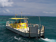 The semi-submarine prepares to take on passengers from the Big Cat at Green Island, along the Great Barrier Reef, near Cairns, QLD, Australia.