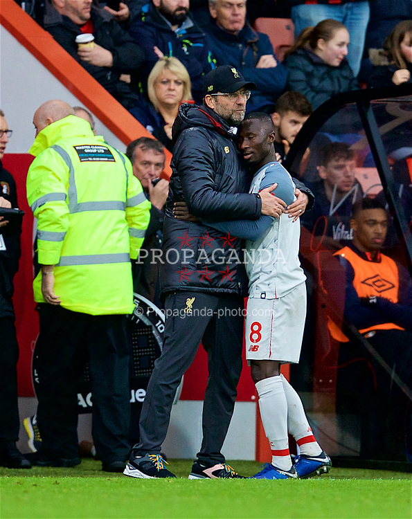 BOURNEMOUTH, ENGLAND - Saturday, December 8, 2018: Liverpool's manager Jürgen Klopp embraces Naby Keita after substituting him during the FA Premier League match between AFC Bournemouth and Liverpool FC at the Vitality Stadium. (Pic by David Rawcliffe/Propaganda)