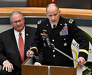 Guest speaker Army General Stephen Lyons, Commander of U.S. Transportation Command at Scott Air Force Base, speaks during the ceremony. Seated at left is Belleville Mayor Mark Eckert. The city of Belleville held their 21st annual Veterans Day ceremony inside Belleville City Hall on Thursday November 11, 2019. It was moved inside due to the winter weather.<br /> Photo by Tim Vizer