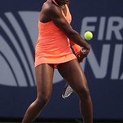 Sloane Stephens, USA, wearing an array of matching orange, in action against Julia Goerges, Germany, during the New Haven Tennis Open at Yale, Connecticut, USA. 20th August 2013. Photo Tim Clayton