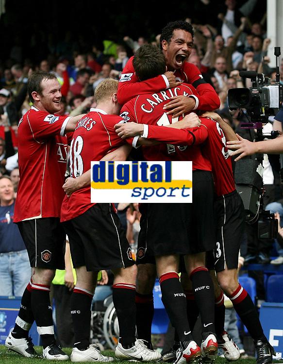 Photo: Paul Thomas.<br /> Everton v Manchester United. The Barclays Premiership. 28/04/2007.<br /> <br /> Kieran Richardson (Top) and his team-mates of Man Utd mop goal scorer Chris Eagles.