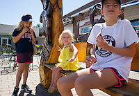 Sadie, Winnie and Eliot 5th generation summer visitors to Wolfeboro enjoy a gingerbread cookie from the Yum Yum Shop on Main Street.  ©2016 Karen Bobotas Photographer