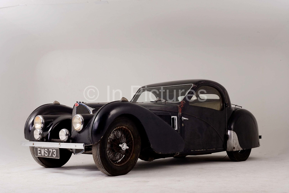 Found in a garage where it had been stored virtually untouched for 50 years, this 1937 Bugatti Type 57s Atalante sports car is previewed for the first time before a Bonhams auction in Paris on February 7th 2009. Here, we see the car in a garage/studio before the auction and sale in Paris. In 2008 the Bugatti Type 57S with chassis number 57502 built in 1937 with the Atalante coachwork for Earl Howe was discovered in a private garage in Newcastle upon Tyne, having been stored untouched for 48 years and known about only by a select few people. It was auctioned in February 2009 at the Retromobile motor show in Paris, France, fetching €3.4 million (US$4.6 million), becoming one of the highest valued cars in automotive history, owing much to its extremely low mileage, original condition and ownership pedigree.