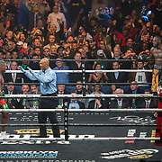 Deontay Wilder (R) waits in the neutral corner as Luis Ortiz receives a standing count during the WBC Heavyweight Championship boxing match at Barclays Center on Saturday, March 3, 2018 in Brooklyn, New York. Wilder would win the bout by knockout in the tenth round to retain the title and move to 40-0. (Alex Menendez via AP)
