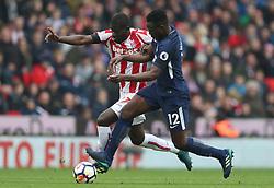 Stoke City's Badou Ndiaye (left) and Tottenham Hotspur's Victor Wanyama battle for the ball