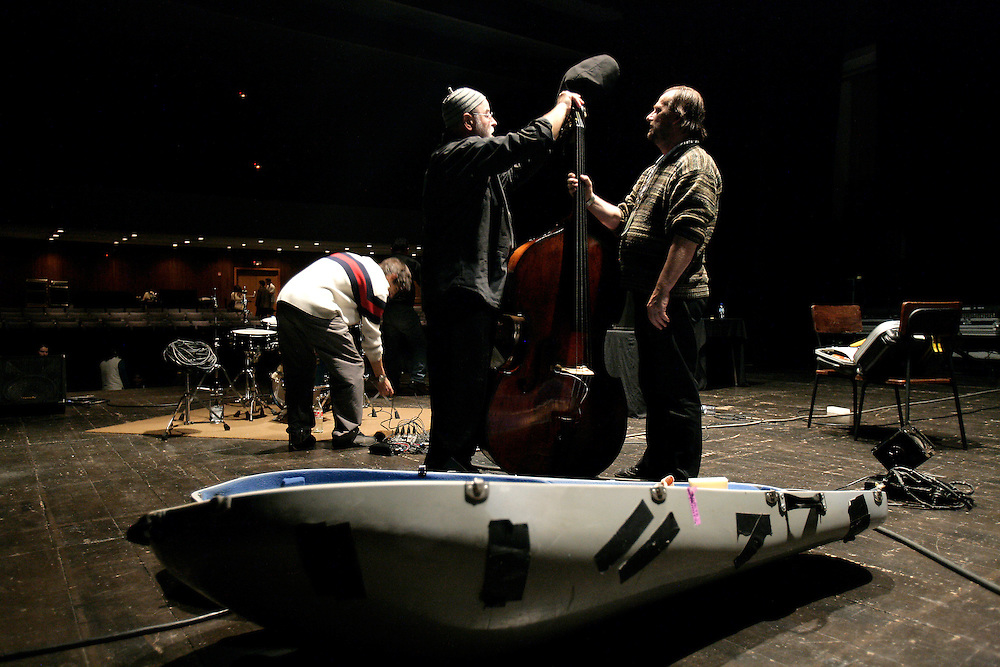 """French bass player Henri Texier storing his instrument after a performance. """"Jazz ao Centro"""" jazz festival is held twice a year in portuguese town of Coimbra."""