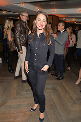 TV Presenter REBECCA JACKSON at a party hosted by Donna Ida to celebrate 'A Decade in Denim' held at The hari Hotel, 20 Chesham Place, London on 11th October 2016.