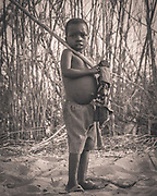 Boy returning from the fields in the heart of Mozambique, close to the re-emerging Gorongosa National Park. Being regenerated with the support of American philanthropist Gregg Carr the local communities are closely involved (and rewarded) for any development and growth.
