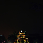 Night time by Hoan Kiem Lake, Hanoi, Vietnam, with the Thap Rue Pagoda visible in the distance. Hanoi, Vietnam. 17th March 2012. Photo Tim Clayton
