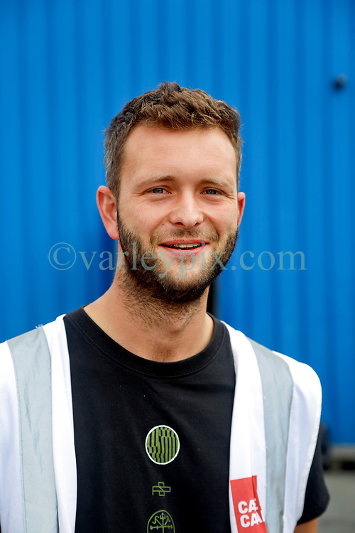 31 July 2021. Calais, France.<br /> Matt Cowling, operations co-ordinator for <br /> British founded charity Care4Calais at their warehousing complex in Calais. The charity offers food, clothing, shelter in the form of tents, tarps, blankets and other services to migrant refugees in Calais and Dunkerque.  With police ramping up efforts to make Calais as hostile as possible, many migrants have taken to living in swampy inhospitable terrain spread around the town. <br /> Photo©; Charlie Varley/varleypix.com