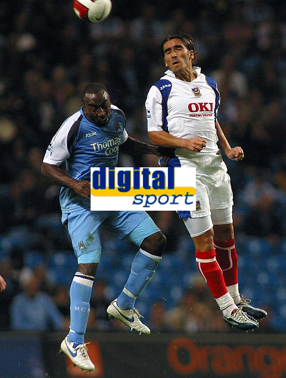 Photo: Paul Thomas.<br /> Manchester City v Portsmouth. The Barclays Premiership. 23/08/2006.<br /> <br /> Darius Vassell (L) of Man City is out jumped by Pedro Mendes.